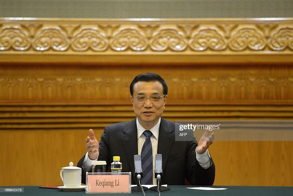 China's Premier Li Keqiang delivers a speech as he meets with CEOs who will attend the Chengdu Fortune Forum at the Great Hall of the People in Beijing on June 5, 2013. The Fortune Global Forum will be held from 6-8 June in Chengdu, southwest China's Sichuan province.