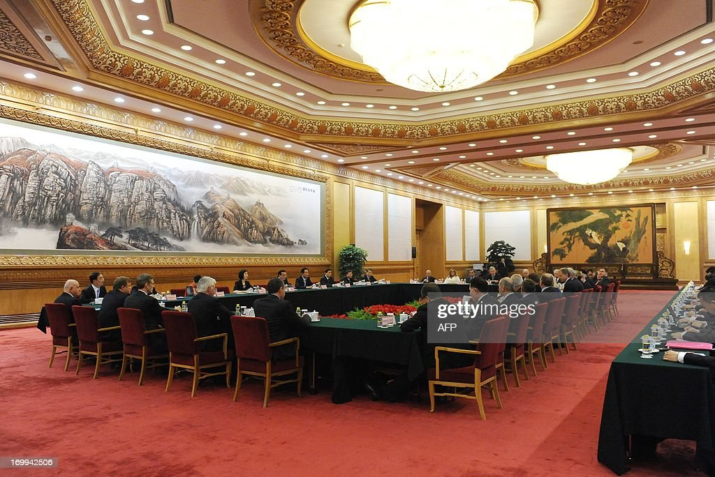 China's Premier Li Keqiang (5th-far-L) delivers a speech as he meets with CEOs who will attend the Chengdu Fortune Forum at the Great Hall of the People in Beijing on June 5, 2013. The Fortune Global Forum will be held from 6-8 June in Chengdu, southwest China's Sichuan province.