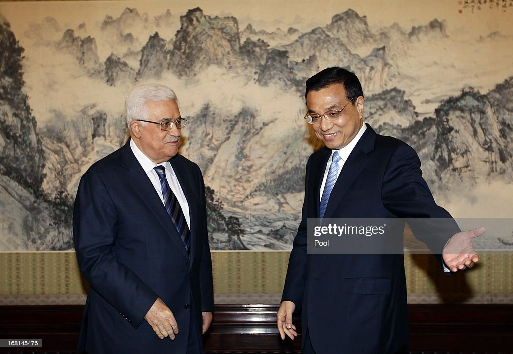 China's Premier <a gi-track='captionPersonalityLinkClicked' href=/galleries/search?phrase=Li+Keqiang&family=editorial&specificpeople=2481781 ng-click='$event.stopPropagation()'>Li Keqiang</a> gestures to Palestinian President Mahmoud Abbas (L) during a meeting at the Zhongnanhai compound on May 6, 2013 in Beijing, China. Abbas is visiting China from May 5 to 7.