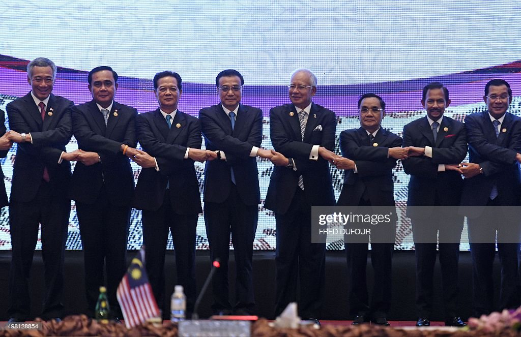 China's Premier Li Keqiang joins hands with ASEAN leaders as he takes part in the ASEANChina meeting part of the 27th Association of Southeast Asian...