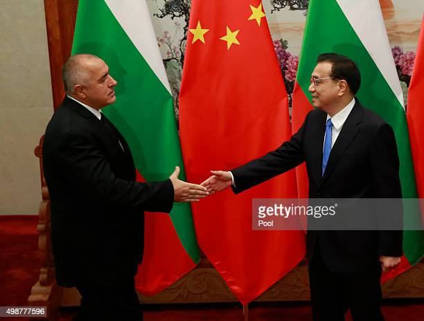 China's Premier Li Keqiang shakes hands with Bulgarian Prime Minister Boiko Borisov during their meeting on the sideline of the 4th Meeting of Heads...