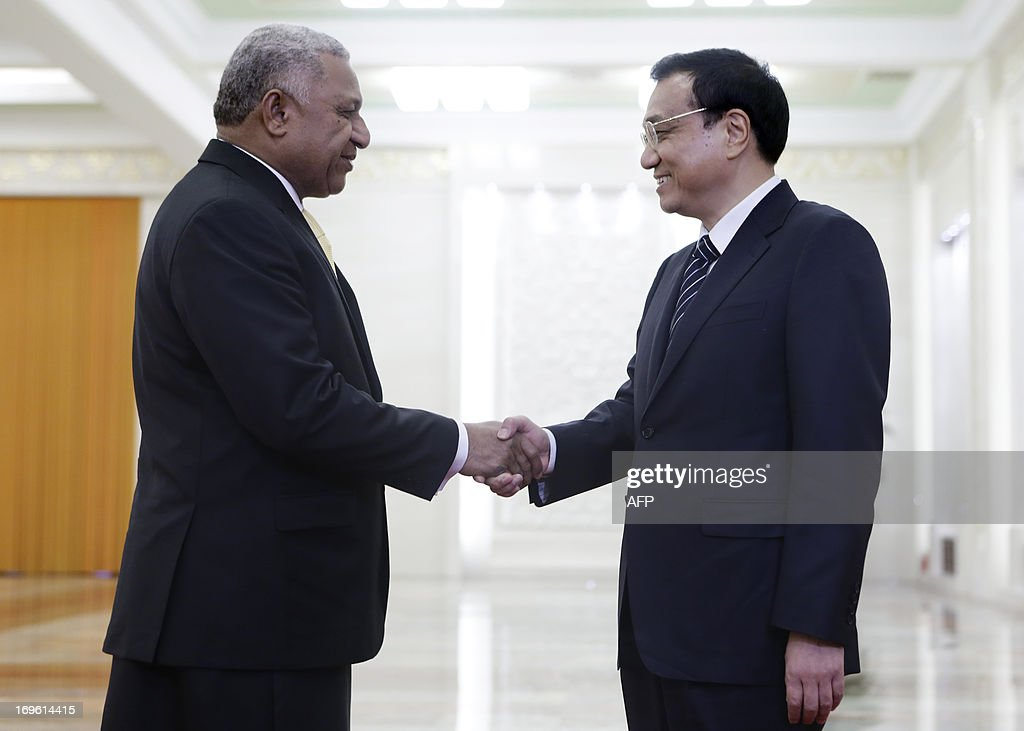 China's Premier Li Keqiang shakes hands with Fiji's Prime Minister Josaia V. Bainimarama (L) during a meeting at the Great Hall of the People in Beijing on May 29, 2013.