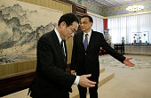 China's Premier Li Keqiang shows the way to Japanese Foreign Minister Fumio Kishida during a meeting at Zhongnanhai in Beijing on April 30 2016 / AFP...