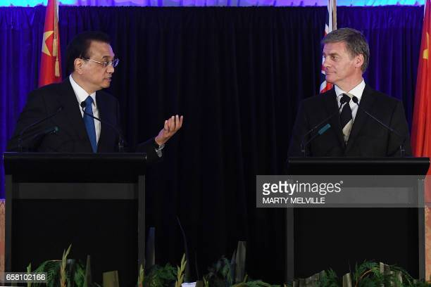 China's Premier Li Keqiang speaks at a joint press conference with New Zealand's Prime Minister Bill English in Wellington on March 27 2017 Li is on...