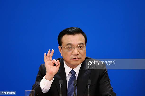 China's Premier Li Keqiang speaks during a press conference after the closing session of the National People's Congress at the Great Hall of the...