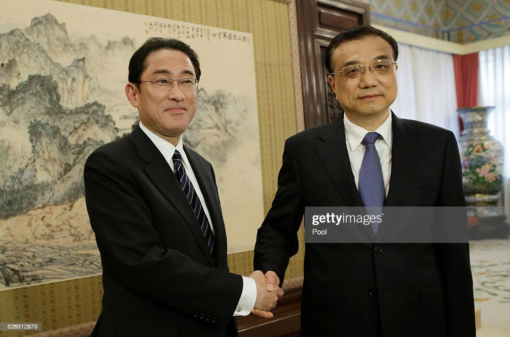 China's Premier Li Keqiang (R) talks with Japanese Foreign Minister Fumio Kishida during a meeting at Zhongnanhai on April 30, 2016 in Beijing, China.