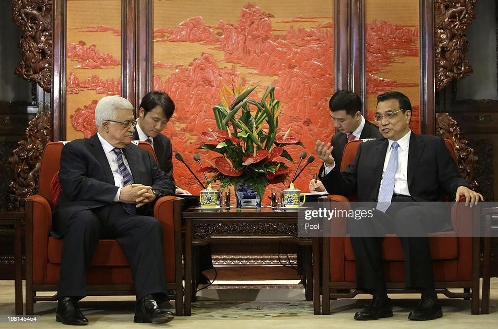 China's Premier <a gi-track='captionPersonalityLinkClicked' href=/galleries/search?phrase=Li+Keqiang&family=editorial&specificpeople=2481781 ng-click='$event.stopPropagation()'>Li Keqiang</a> talks with Palestinian President Mahmoud Abbas (L) during a meeting at the Zhongnanhai compound on May 6, 2013 in Beijing, China. Abbas is visiting China from May 5 to 7.