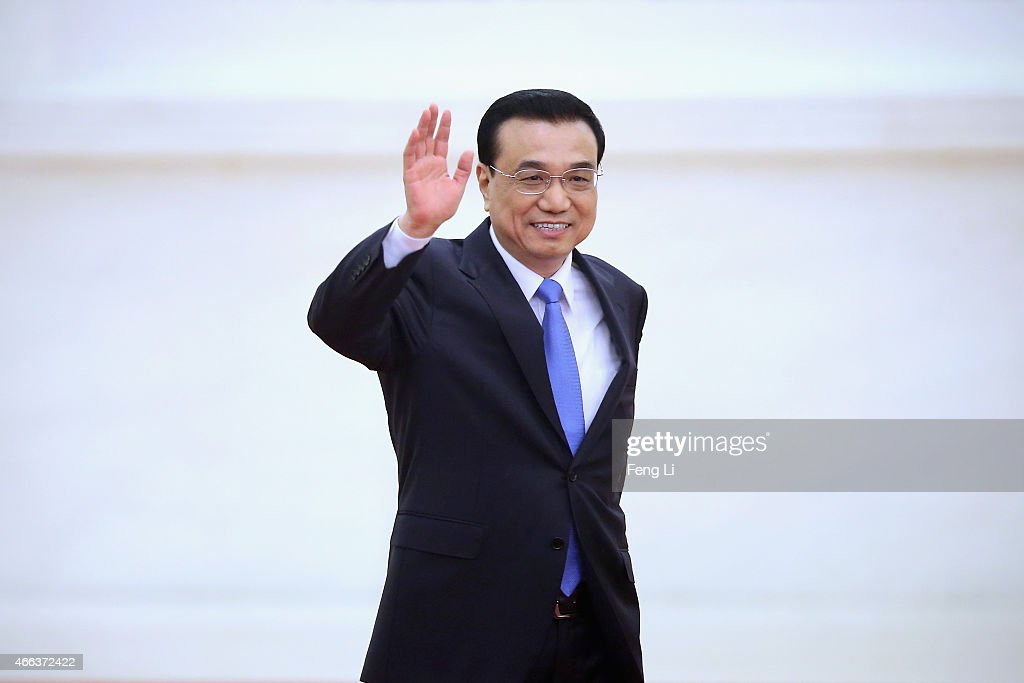 China's Premier <a gi-track='captionPersonalityLinkClicked' href=/galleries/search?phrase=Li+Keqiang&family=editorial&specificpeople=2481781 ng-click='$event.stopPropagation()'>Li Keqiang</a> waves as arriving the annual news conference following the closing session of the National People's Congress at the Great Hall of the People on March 15, 2015 in Beijing, China.