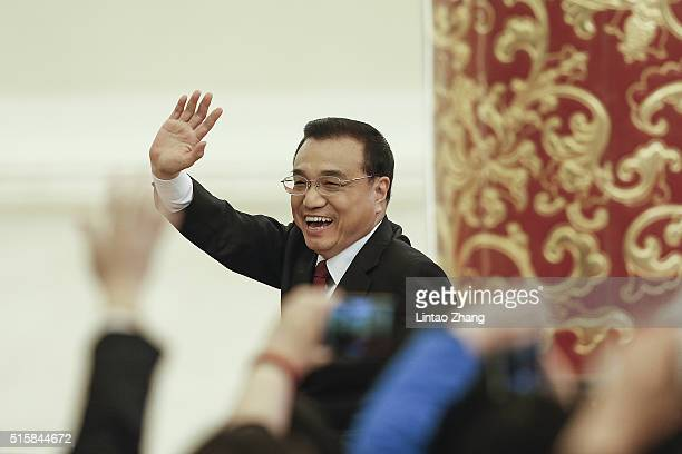 China's Premier Li Keqiang waves as leaving the annual news conference following the closing session of the National People's Congress at the Great...