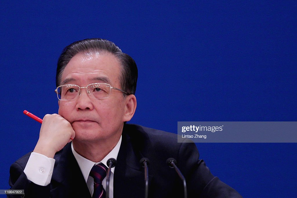 China's Premier <a gi-track='captionPersonalityLinkClicked' href=/galleries/search?phrase=Wen+Jiabao&family=editorial&specificpeople=204598 ng-click='$event.stopPropagation()'>Wen Jiabao</a> gestures as he answers a question during his annual press conference after the closing of the session of the National People's Congress held at the Great Hall of the People on March 14, 2011 in Beijing, China. The Chinese Premier has called for political reform, stating 'the economic achievements of the last 30 years could be lost without 'institutional' changes.