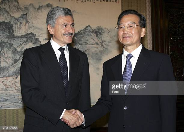 China's Premier Wen Jiabao shakes hands with Italy's Foreign Minister Massimo D'Alema during a meeting November 13 2006 in Beijing China Foreign...