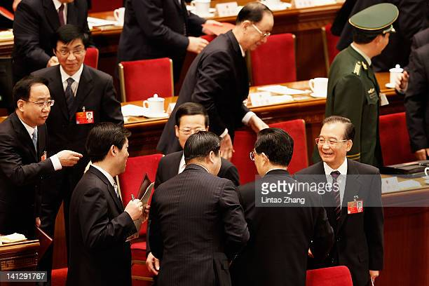 China's Premier Wen Jiabao stands with President Hu Jintao after the closing session of the National Peoples Congress at The Great Hall Of The People...