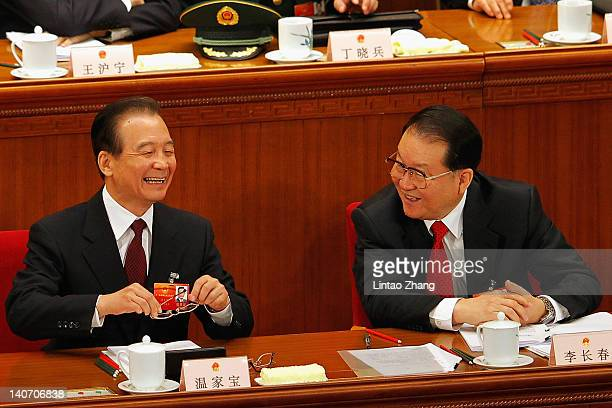 China's Premier Wen Jiabao talk with Li Changchun a member of the standing committee of the political bureau of CPC during the opening ceremony of...