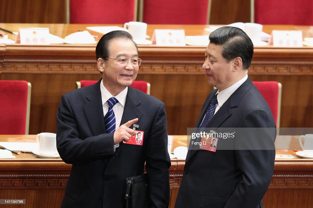 China's Premier Wen Jiabao (L) talks to Vice President Xi Jinping (R) as they leave after the fourth plenary meeting of the National People's Congress (NPC) at The Great Hall Of The People on March 11, 2012 in Beijing, China. Known as 'liang hui,' or 'two organizations', it consists of meetings of China's legislature, the National People's Congress (NPC), and its advisory auxiliary, the Chinese People's Political Consultative Conference (CPPCC).