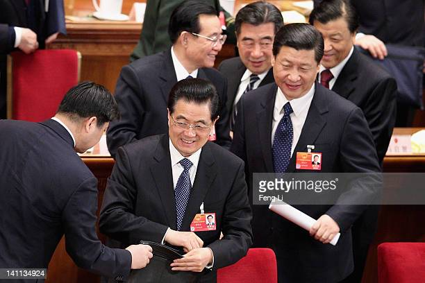 China's President Hi Jintao and Vice President Xi Jinping leave after the fourth plenary meeting of the National People's Congress at The Great Hall...