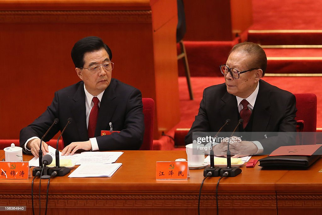 China's President Hu Jintao (L) and former President Jiang Zemin (R) attend the closing session of the 18th National Congress of the Communist Party of China (CPC) at the Great Hall of the People on November 14, 2012 in Beijing, China. Members of the Standing Committee of the Political Bureau of the new CPC Central Committee will meet with journalists on November 15, 2012.