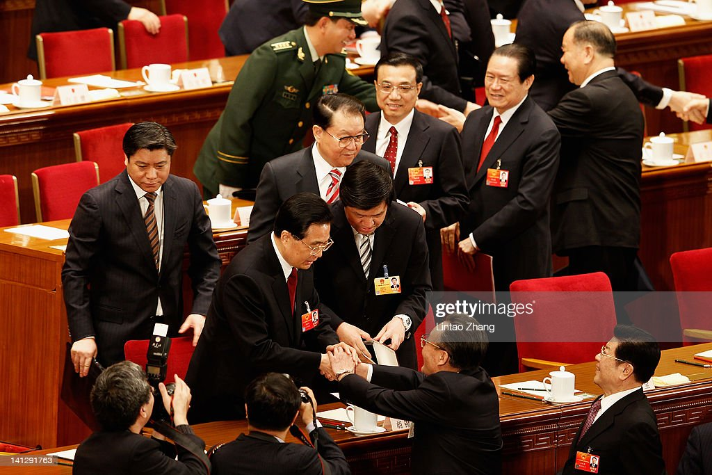 China's President <a gi-track='captionPersonalityLinkClicked' href=/galleries/search?phrase=Hu+Jintao&family=editorial&specificpeople=203109 ng-click='$event.stopPropagation()'>Hu Jintao</a> (C) shakes hands with China's Chairman of the Standing Committee of the National People's Congress <a gi-track='captionPersonalityLinkClicked' href=/galleries/search?phrase=Wu+Bangguo&family=editorial&specificpeople=604934 ng-click='$event.stopPropagation()'>Wu Bangguo</a> after the closing session of the National Peoples Congress (NPC) at The Great Hall Of The People on March 14, 2012 in Beijing, China. The National People's Congress (NPC), China's parliament, adopted the revision to the Criminal Procedure Law at the closing session of its annual session today.