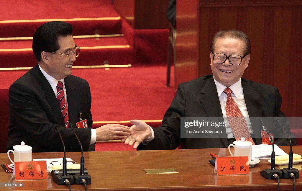 China's President Hu Jintao (L) shakes hands with former president <a gi-track='captionPersonalityLinkClicked' href=/galleries/search?phrase=Jiang+Zemin&family=editorial&specificpeople=159399 ng-click='$event.stopPropagation()'>Jiang Zemin</a> after he delivered a speech during the opening session of the five-yearly Chinese Communist Party Congress at the Great Hall of the People on October 15, 2007 in Beijing, China. The congress, which is held from October 15 to 21, will promote younger leaders and likely successors to President Hu Jintao and Premier Wen Jiabao five years hence.
