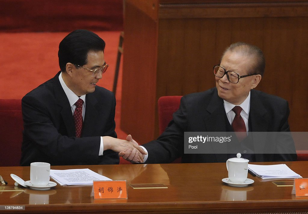 China's President <a gi-track='captionPersonalityLinkClicked' href=/galleries/search?phrase=Hu+Jintao&family=editorial&specificpeople=203109 ng-click='$event.stopPropagation()'>Hu Jintao</a> (L) shakes hands with former president <a gi-track='captionPersonalityLinkClicked' href=/galleries/search?phrase=Jiang+Zemin&family=editorial&specificpeople=159399 ng-click='$event.stopPropagation()'>Jiang Zemin</a> after making a speech at the Commemoration of the 100th anniversary of the Xinhai Revolution at the Great Hall of the People on October 9, 2011 in Beijing, China. The Xinhai Revolution in 1911 toppled the Qing Dynasty, which was the last of the 2000 years of imperial rule in China. Speaking at the commemoration Chinese President <a gi-track='captionPersonalityLinkClicked' href=/galleries/search?phrase=Hu+Jintao&family=editorial&specificpeople=203109 ng-click='$event.stopPropagation()'>Hu Jintao</a> made mention of the importance of uniting China's ethnic groups.
