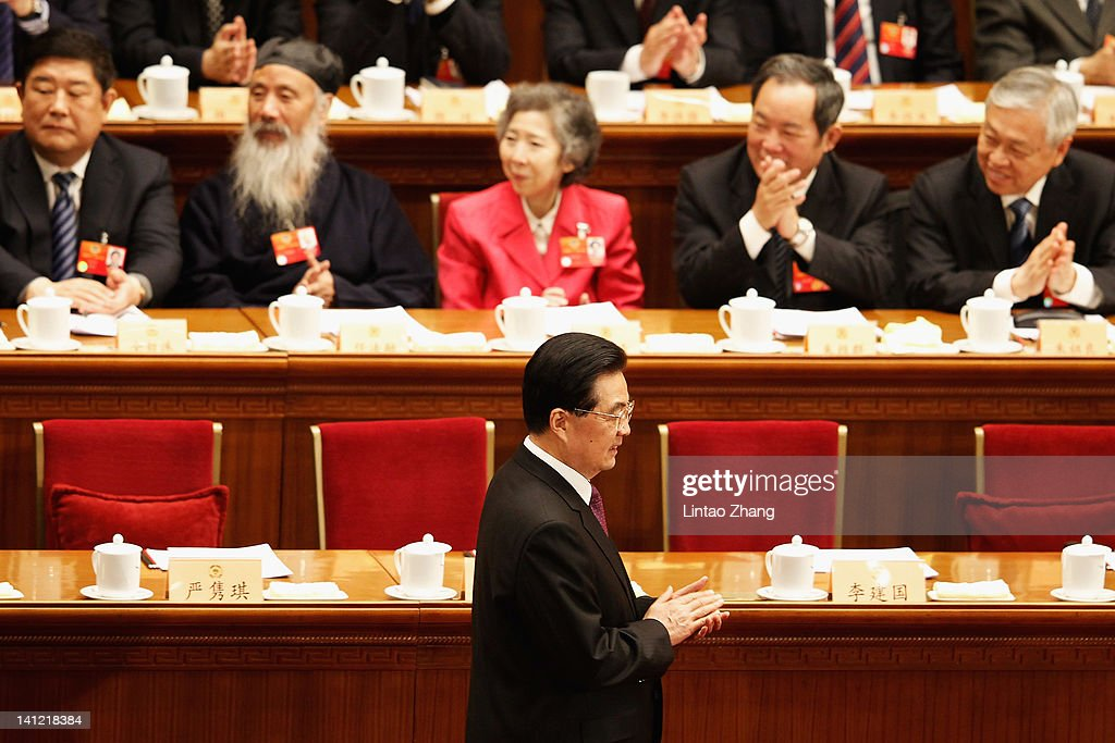 China's President Hu Jintao walks as he arrives for the closing session of the National Committee of the Chinese People's Political Consultative Conference (CPPCC) at the Great Hall of the People on March 13, 2012 in Beijing, China. Known as 'liang hui,' or 'two organizations', it consists of meetings of China's legislature, the National People's Congress (NPC), and its advisory auxiliary, the Chinese People's Political Consultative Conference (CPPCC).