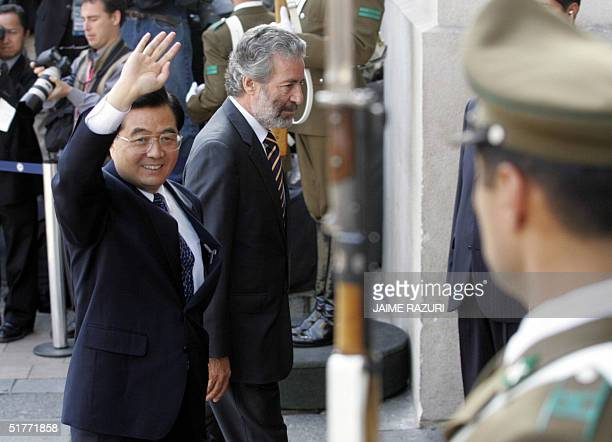 China's President Hu Jintao waves as he enters at La Moneda Presidential Palace to attend the opening of the APEC leaders' 2nd retreat AFP PHOTO/...