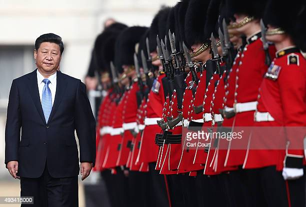 China's President Xi Jinping accompanied by Prince Philip reviews an honour guard on October 20 2015 in London England The President of the People's...