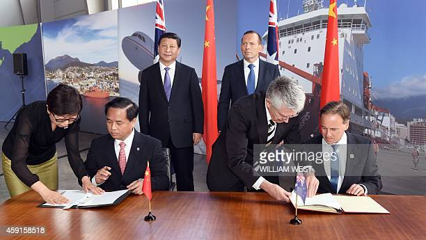 China's President Xi Jinping and Australia's Prime Minister Tony Abbott look on as China's Administrator of the State Oceanic Administration Liu...