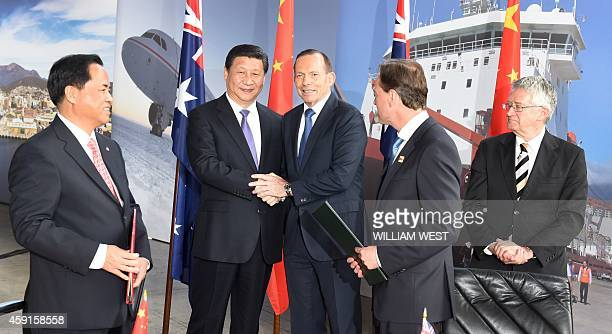 China's President Xi Jinping and Australia's Prime Minister Tony Abbott shake hands after China's Administrator of the State Oceanic Administration...