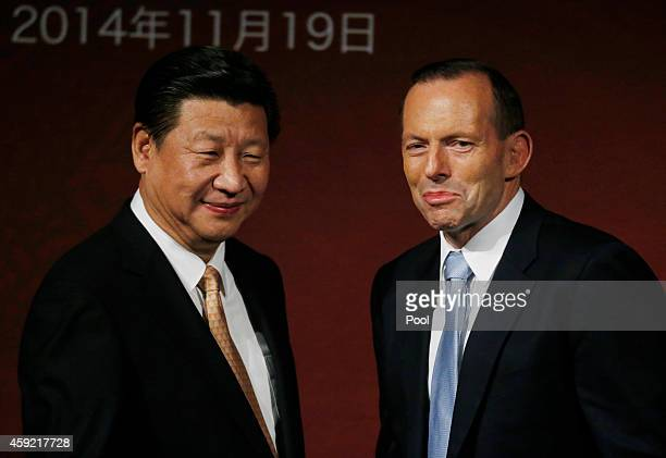 China's President Xi Jinping and Australia's Prime Minister Tony Abbott are pictured on stage after addressing the Australia China state and...