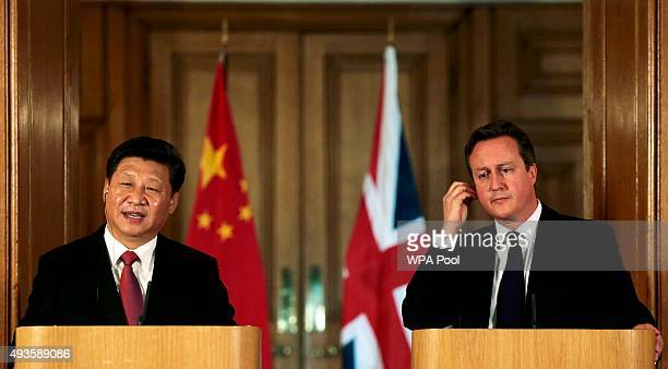 China's President Xi Jinping and Britain's Prime Minister David Cameron attend a joint press conference in 10 Downing Street on October 21 2015 in...