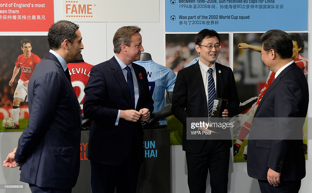 China's President <a gi-track='captionPersonalityLinkClicked' href=/galleries/search?phrase=Xi+Jinping&family=editorial&specificpeople=2598986 ng-click='$event.stopPropagation()'>Xi Jinping</a> (R) and Britain's Prime Minister <a gi-track='captionPersonalityLinkClicked' href=/galleries/search?phrase=David+Cameron+-+Politician&family=editorial&specificpeople=227076 ng-click='$event.stopPropagation()'>David Cameron</a> (2L) are introduced to former Manchester City player <a gi-track='captionPersonalityLinkClicked' href=/galleries/search?phrase=Sun+Jihai&family=editorial&specificpeople=228898 ng-click='$event.stopPropagation()'>Sun Jihai</a> (2R) by Manchester City chairman <a gi-track='captionPersonalityLinkClicked' href=/galleries/search?phrase=Khaldoon+Al+Mubarak&family=editorial&specificpeople=5534897 ng-click='$event.stopPropagation()'>Khaldoon Al Mubarak</a> (L) during a visit to the City Football Academy on October 23, 2015 in Manchester, England. The President of the People's Republic of China, <a gi-track='captionPersonalityLinkClicked' href=/galleries/search?phrase=Xi+Jinping&family=editorial&specificpeople=2598986 ng-click='$event.stopPropagation()'>Xi Jinping</a> and his wife, Madame Peng Liyuan, are paying a State Visit to the United Kingdom as guests of The Queen. They will stay at Buckingham Palace and undertake engagements in London and Manchester. The last state visit paid by a Chinese President to the UK was Hu Jintao in 2005.