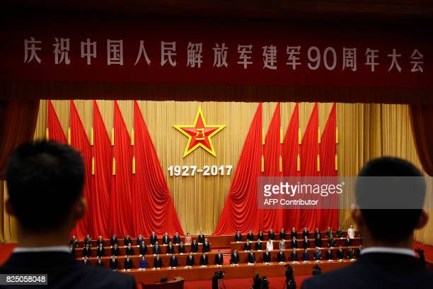 TOPSHOT China's President Xi Jinping and delegates stand during the singing of the Chinese national anthem at a ceremony to commemorate the 90th...