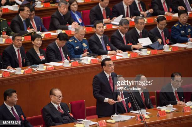 China's President Xi Jinping and former president Jiang Zemin listen to Premier Li Keqiang during the opening session of the Chinese Communist...