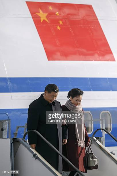 China's President Xi Jinping and his wife Peng Liyuan disembark from their plane upon their arrival for a state visit to Switzerland on January 15...