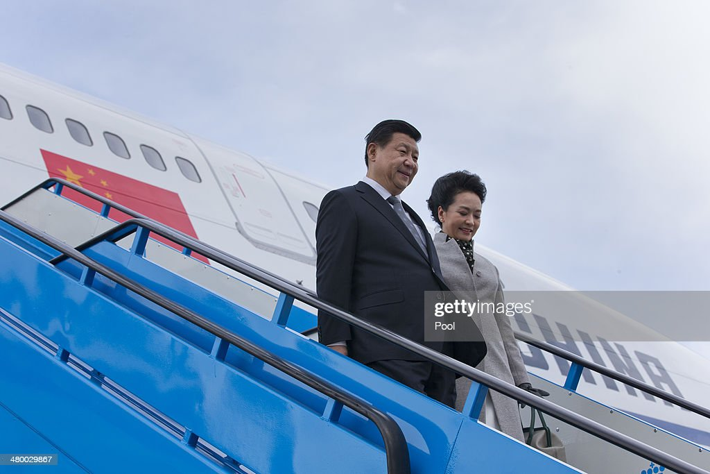 China's President <a gi-track='captionPersonalityLinkClicked' href=/galleries/search?phrase=Xi+Jinping&family=editorial&specificpeople=2598986 ng-click='$event.stopPropagation()'>Xi Jinping</a> and his wife <a gi-track='captionPersonalityLinkClicked' href=/galleries/search?phrase=Peng+Liyuan&family=editorial&specificpeople=4379390 ng-click='$event.stopPropagation()'>Peng Liyuan</a> walk down the stairs from their aircraft prior to being greeted by King Willem-Alexander of the Netherlands and Queen Maxima of the Netherlands at Schiphol Amsterdam airport on March 22, 2014 in Amsterdam, Netherlands. Xi is on a two-day state visit ahead of the March 24 and 25 Nuclear Security Summit in The Hague.