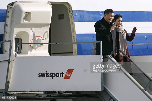 China's President Xi Jinping and his wife Peng Liyuan wave upon their arrival for a state visit to Switzerland on January 15 2017 at Zurich Airport...