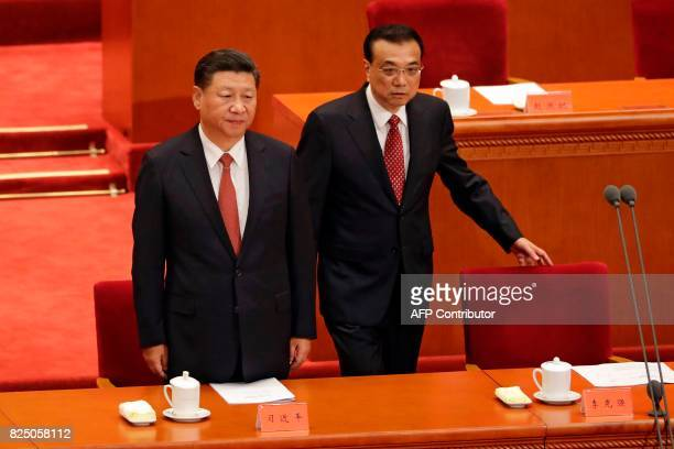 China's President Xi Jinping and Premier Li Keqiang arrive for a ceremony to commemorate the 90th anniversary of the founding of the People's...