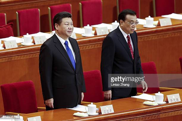 China's President Xi Jinping and Premier Li Keqiang attends the opening session of the Chinese People's Political Consultative Conference on March 3...