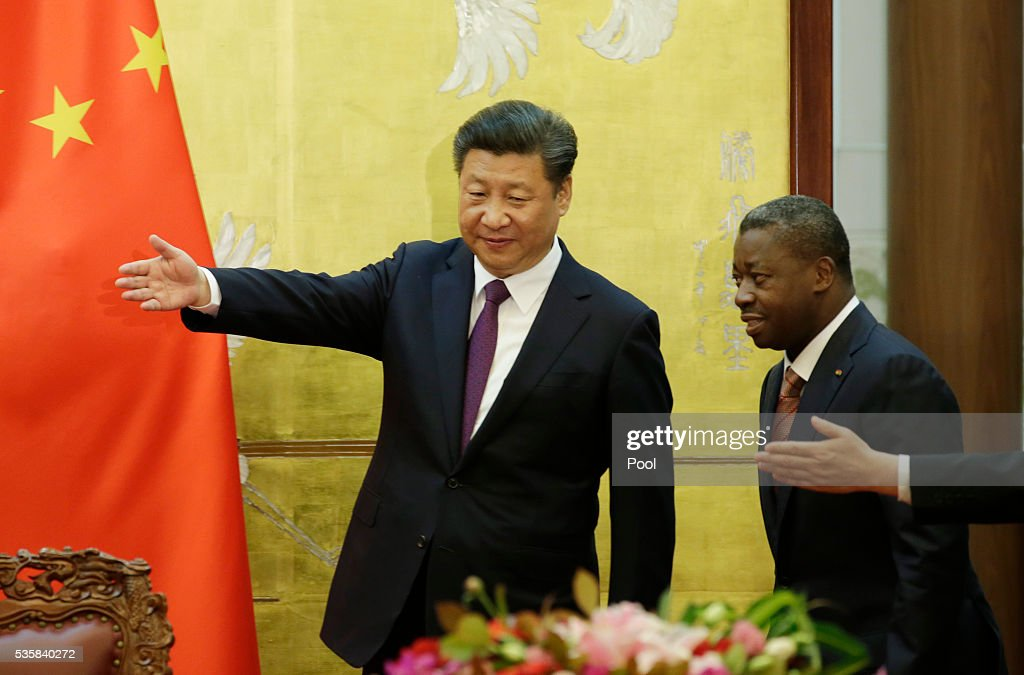 China's President <a gi-track='captionPersonalityLinkClicked' href=/galleries/search?phrase=Xi+Jinping&family=editorial&specificpeople=2598986 ng-click='$event.stopPropagation()'>Xi Jinping</a> (L) and Togo's President Faure Gnassingbe attend a signing ceremony at the Great Hall of the People May 30, 2016 in Beijing, China. Photo by Jason Lee - Pool /Getty Images)
