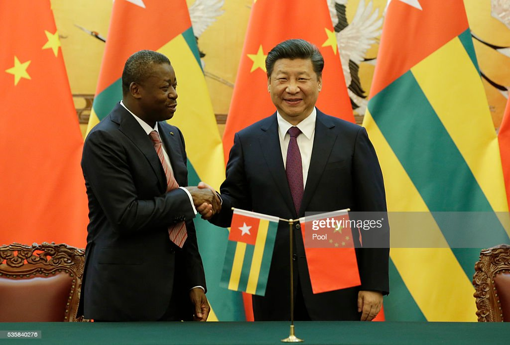 China's President <a gi-track='captionPersonalityLinkClicked' href=/galleries/search?phrase=Xi+Jinping&family=editorial&specificpeople=2598986 ng-click='$event.stopPropagation()'>Xi Jinping</a> (R) and Togo's President Faure Gnassingbe attend a signing ceremony at the Great Hall of the People May 30, 2016 in Beijing, China. Photo by Jason Lee - Pool /Getty Images)