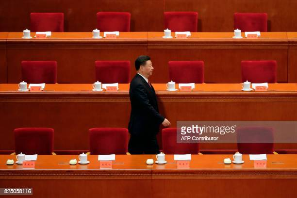 China's President Xi Jinping arrives at a ceremony to commemorate the 90th anniversary of the founding of the People's Liberation Army at the Great...