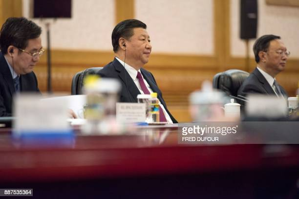 China's President Xi Jinping attends a meeting with Maldives' President Abdulla Yameen at the Great Hall of the People in Beijing on December 7 2017...