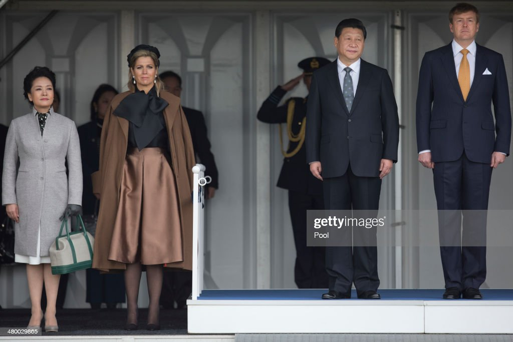 China's President <a gi-track='captionPersonalityLinkClicked' href=/galleries/search?phrase=Xi+Jinping&family=editorial&specificpeople=2598986 ng-click='$event.stopPropagation()'>Xi Jinping</a>, center right, and his wife <a gi-track='captionPersonalityLinkClicked' href=/galleries/search?phrase=Peng+Liyuan&family=editorial&specificpeople=4379390 ng-click='$event.stopPropagation()'>Peng Liyuan</a>, left, are greeted by <a gi-track='captionPersonalityLinkClicked' href=/galleries/search?phrase=King+Willem-Alexander&family=editorial&specificpeople=160214 ng-click='$event.stopPropagation()'>King Willem-Alexander</a> of the Netherlands, right, and his wife Queen Maxima of the Netherlands, centre left, upon Xi's arrival at Schiphol Amsterdam airport on March 22, 2014 in Amsterdam, Netherlands. Xi is on a two-day state visit ahead of the March 24 and 25 Nuclear Security Summit in The Hague.
