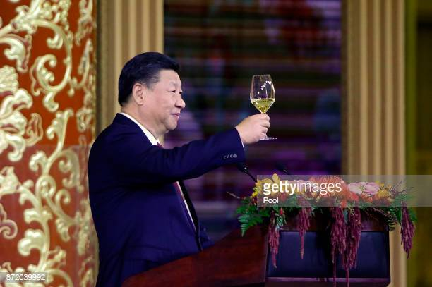 China's President Xi Jinping delivers a toast at a state dinner at the Great Hall of the People on November 9 2017 in Beijing China Trump is on a...