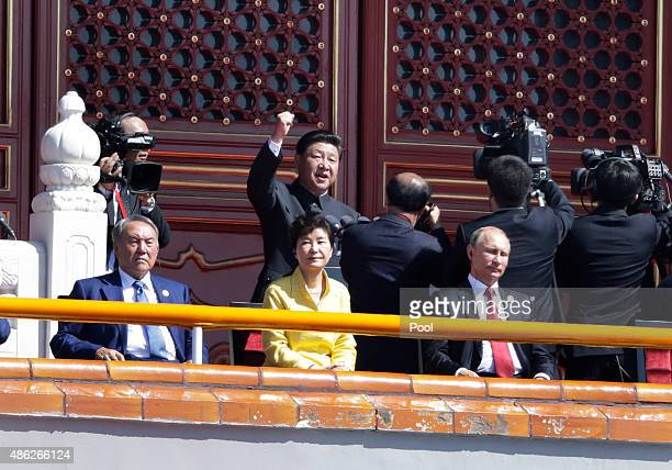 China's President Xi Jinping gestures as he delivers a speech behind Russian President Vladimir Putin South KoreanPresident Park Geunhye and...