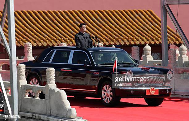 China's President Xi Jinping is carried to inspect troops at a military parade to mark the 70th anniversary of the end of World War Two on September...