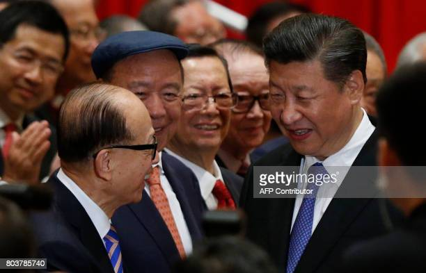 China's President Xi Jinping is greeted by Hong Kong tycoon Li Kashing before a photo session during Xi's visit in Hong Kong on June 30 2017 Xi and...