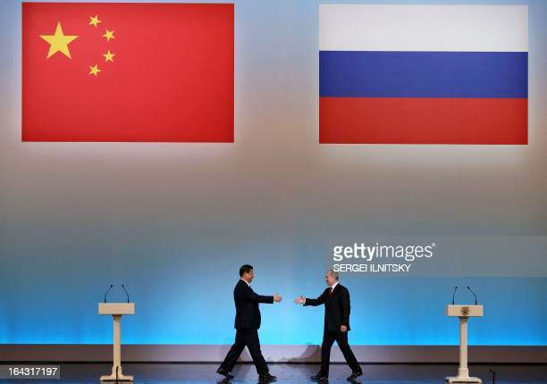 China's President Xi Jinping is welcomed by his Russian counterpart Vladimir Putin during the opening ceremony of 'The Year of Chinese Tourism in...