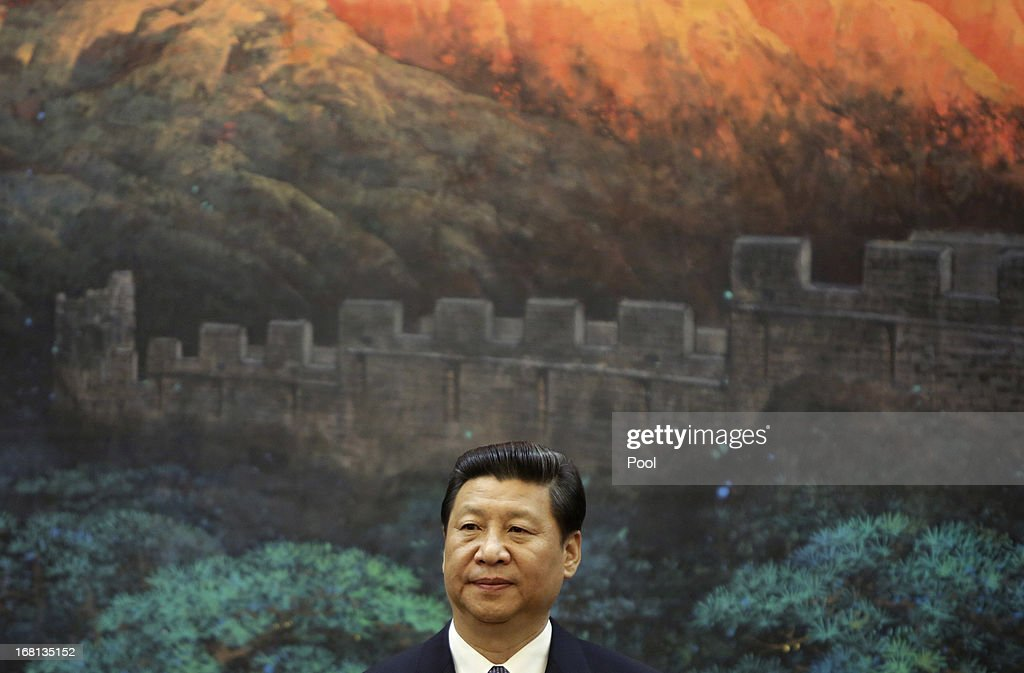 China's President Xi Jinping looks on during a signing ceremony with Palestinian President Mahmoud Abbas at the Great Hall of the People on May 6, 2013 in Beijing, China. Abbas is visiting China from May 5 to 7.