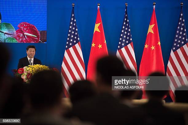 China's President Xi Jinping makes a speech during the joint opening ceremony of the eight round of USChina strategic and economic dialogues and the...